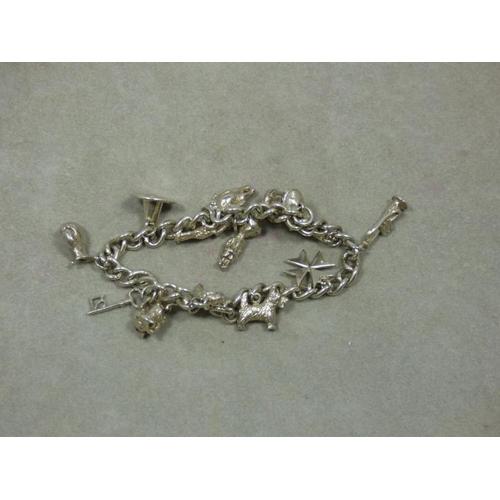 109 - Vintage Silver charm bracelet...