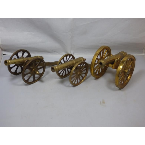 143 - Three vintage brass cannons...