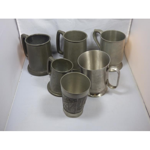 187 - Collection of pewter Tankards includes glass bottomed...