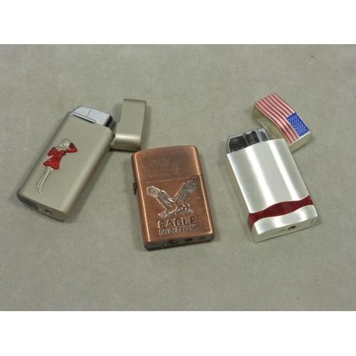28 - Three decorative lighters...