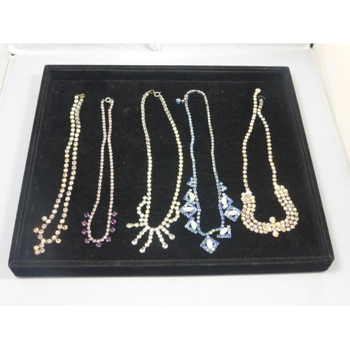 31 - Five vintage costume jewelry necklaces...
