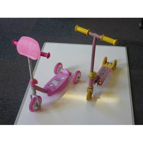 437 - Two children's pink scooters...