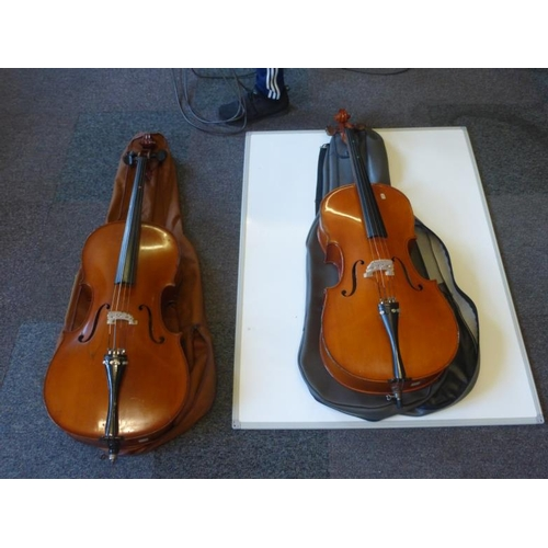 454 - Two cello's with cases...