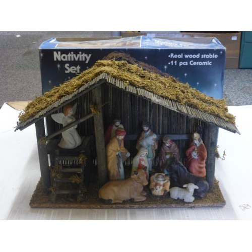 542 - Boxed Nativity scene with wooden stable eleven pieces...