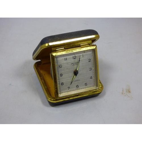 90 - Acme deluxe 2 jewels travel alarm clock...