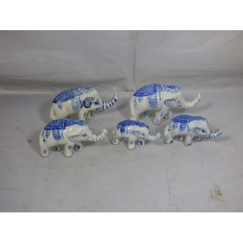 302 - Collection of Five Graduated Blue and White Ceramic Indian Elephants...
