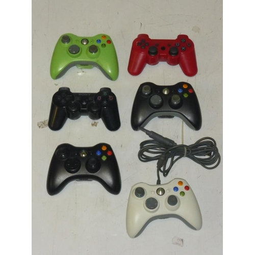 585 - Collection of Xbox 360 and PlayStation 3 controllers...
