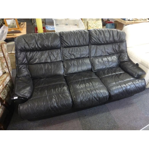 595 - Black leather three seater settee...