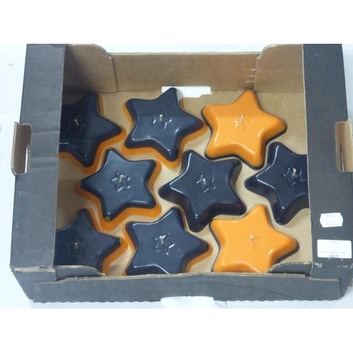 602 - Collection of Halloween themed star shaped candles (will require burning plate)...