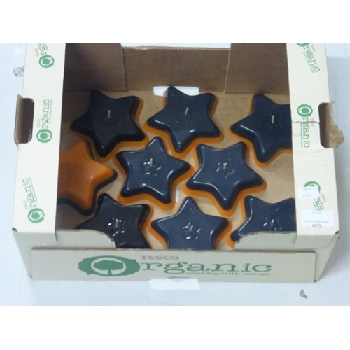 603 - Collection of Halloween themed star shaped candles (will require burning plate)...