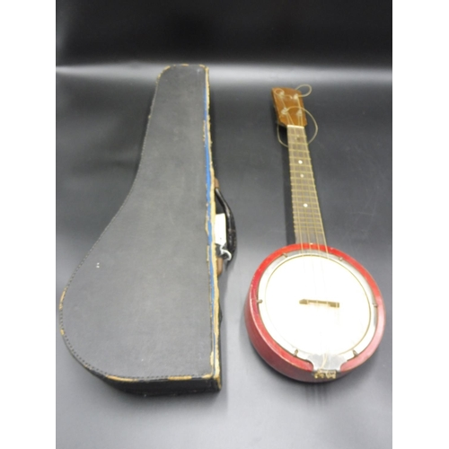 20 - Banjolele complete with Key, Strings and Case...