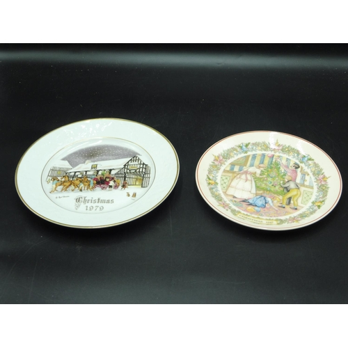 31 - Two Christmas Plates to include Royal Worcester and Wedgwood dating 1987 and 1979...