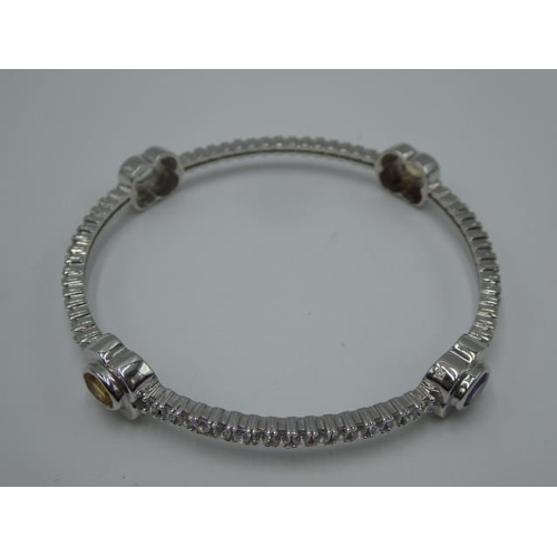 18 - Silver 925 multi stoned bangle in presentation box...