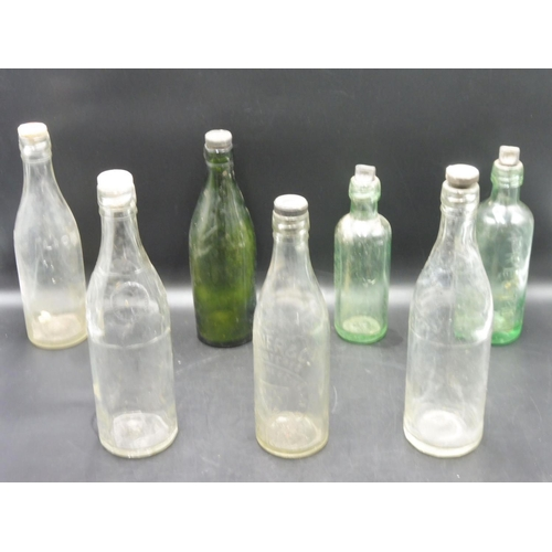 46 - Selection of Seven Vintage Glass Bottles complete with Stoppers...