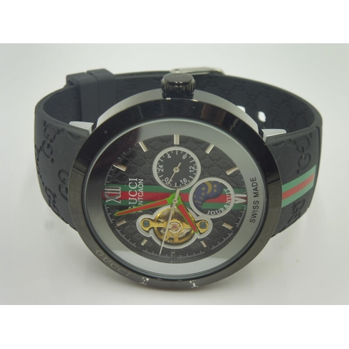 e803bc4b414 315 - Kinetic Gucci watch with rubber Strap (Unauthenticated and presumed  Replica).