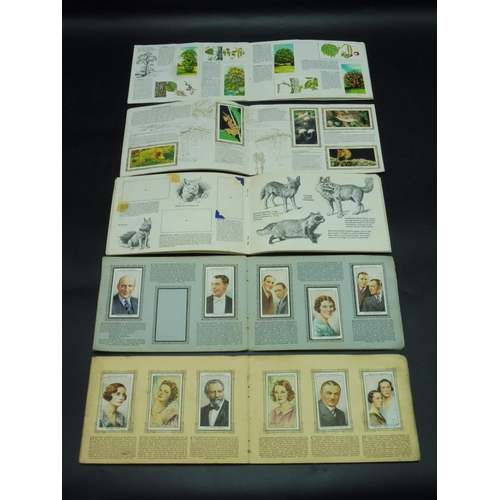 29 - Selection of Albums containing both Cigarette Cards and Tea Cards...