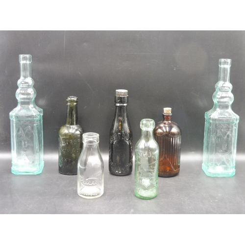 23 - Seven Vintage Mixed Glass Bottles Two with original Stoppers...