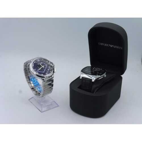 62 - Two watches to include Emporio Armani (Boxed) and Cartier (unauthenticated and presumed replica)...