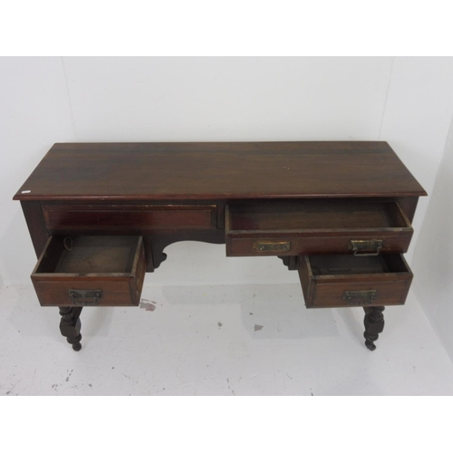 93 - Antique Solid Oak Four Drawer Desk on Casters 35.5