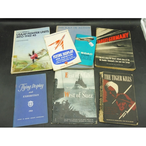 251 - Eight Military Books to include weapons, Badges and more...