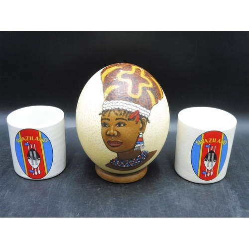 586 - Hand Painted Swaziland Ostrich Egg and two Swaziland Mug's...
