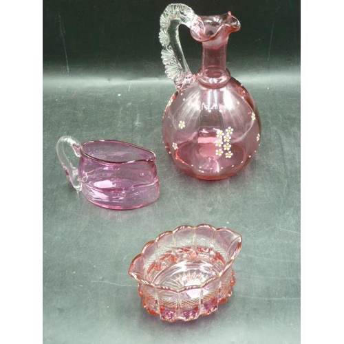 40 - Three Pieces of Cranberry Glass including Milk Jug, Bowl and Decanter...