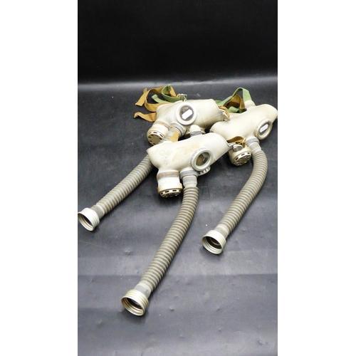 208 - Three PDF Children gas masks with hose...