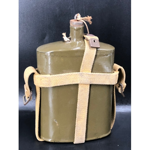 39 - British Army Khaki Coloured Metal Canteen with Webbing Cradle...