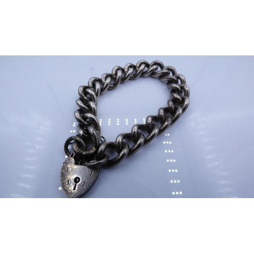 48 - Heavy Silver Bracelet with Padlock Clasp...