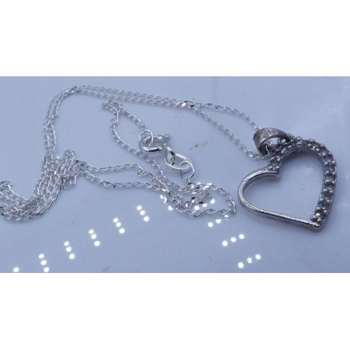 67 - Silver 925 Heart And Diamante Pendant on chain complete with presentation box...