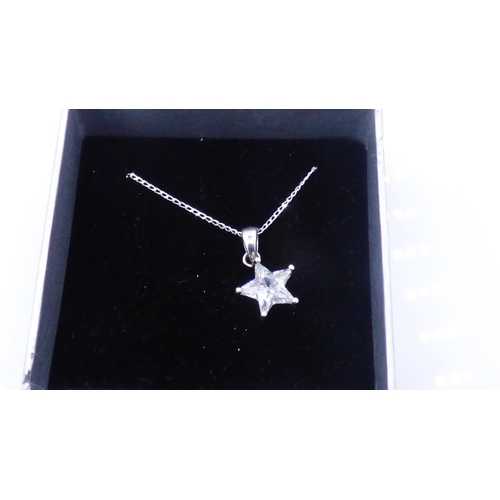 89 - Silver 925 Star Pendant with Chain Complete with Presentation box...