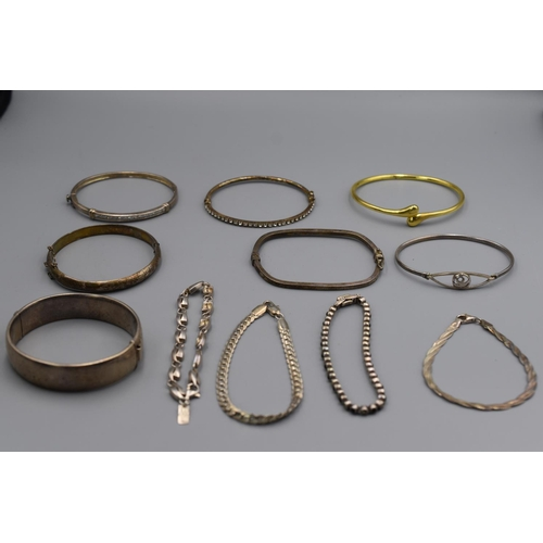 22 - Selection of 11 Silver Bangles and Bracelets...