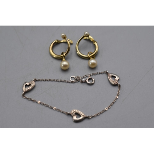 28 - Silver Heart Bracelet and a Pair of Gold on Silver Earrings...
