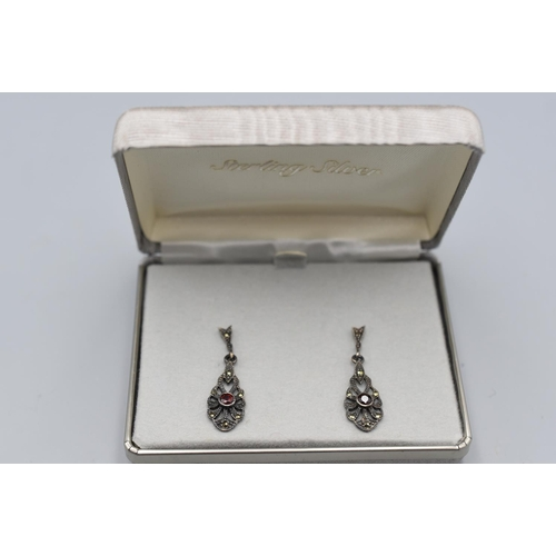 27 - Pair of Sterling Silver Diamante and Ruby Stoned Earrings in Presentation Case...