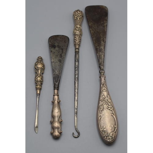 40 - Four Hallmarked Birmingham Silver Handled Shoe Horns and Button Hooks...