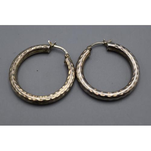 43 - Pair Of Silver Hoop Earrings...
