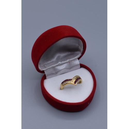 11 - Gold 18ct Wishbone Ring with Ruby and Diamond Decoration (Size O) Complete with Presentation Box (4 ...