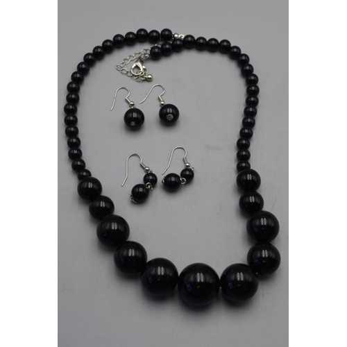 19 - Graduated Black Bead String necklace and two Pairs of Matching Earrings