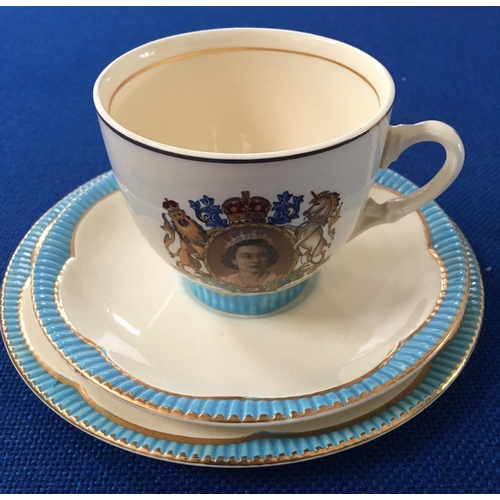 "A highly desirable Coronation set of a teacup, saucer and side plate by ""Clarice Cliff""."