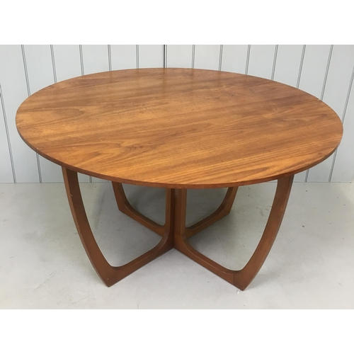 199 - A classic retro teak drop-leaf table. The table is circular above Astro-style legs. Dimensions(cm) (...