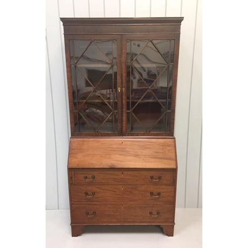 A glass double-door bookcase over a bureau, with three drawers. Key present. Dimensions(cm) H 203 W102 D49