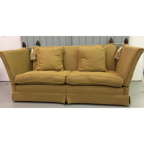 An immaculate large Knole sofa. Gold fabric upholstery. Very stylish. Dimensions(cm) H103 (54 to seat) W220 (324 arms down) D100