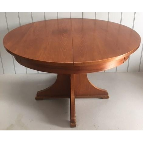 1 - A good extendable teak dining table. Table extends from a round 4-seater to an oval 6-seater. Dimens...
