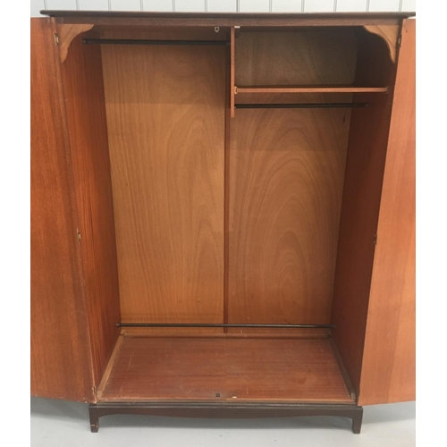 59 - A vintage Stag Minstrel S.150 double wardrobe. Two hanging rails (full and trouser length) and a sho...