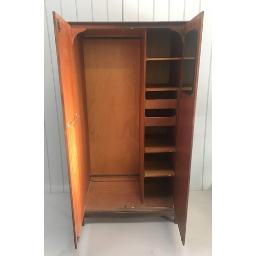 60 - A vintage Stag Minstrel S.156 compactum wardrobe. One hanging rail, a shoe rail and a tie/scarf rail...