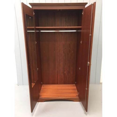 3 - A substantial, vintage Stag Double Wardrobe. Dimensions(cm) H199 W99 D63...