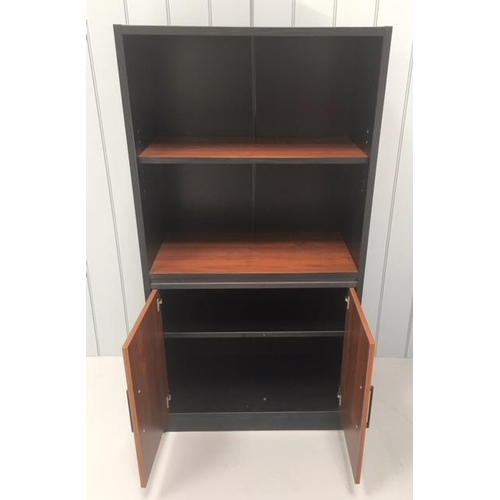 6 - An MDF modern office cupboard, consisting of a single shelf above a two-door cupboard. Black and wal...