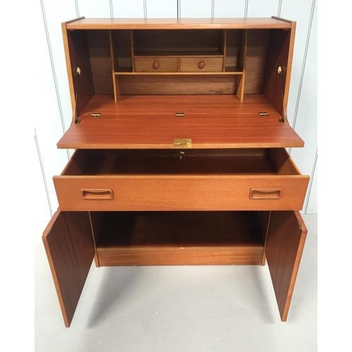 7 - A good mid-century Teak Bureau. Drop-down door desk over 2 drawers and a single-shelf 2-door cupboar...