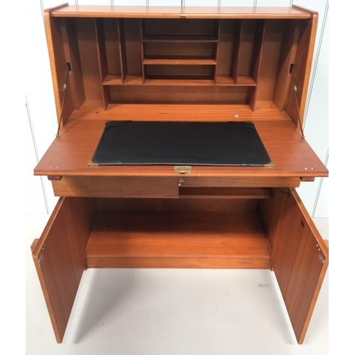 14 - An unusual Bureau by Remploy. A drop-down desk sits over 2 drawers and a 2-door, single-shelved, cup...