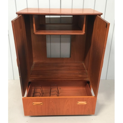 10 - A G-Plan Teak TV Cabinet. 2-door cupboard, over a single drawer. Drawer has dividers in place. Unit ...